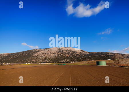 Tilled fields of rich soil near Zafarraya in the the municipality of Alhama de Granada, province of Granada, Spain - Stock Image