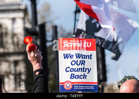 'We want our country back', protesters gathered in Parliament Square outside the Houses of Parliament in Westminster angry at the UK not leaving EU - Stock Image