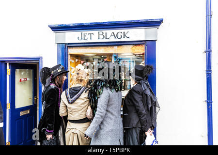 Whitby Jet shop, window shopping, looking through window, Whitby goths, Whitby jet, shop, shopping, shops, goths, window, Whitby Yorkshire UK England - Stock Image