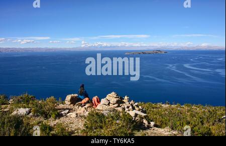 View of the entire Cordillera Real across Lake Titicaca, Isla del Sol, Bolivia - Stock Image