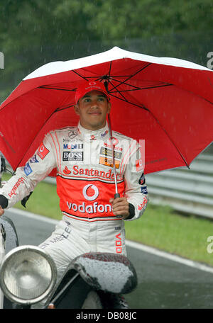 British Formula One driver Lewis Hamilton of McLaren Mercedes stands in the rain during a photo session at the Nuerburgring, - Stock Image