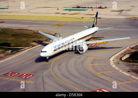 Singapore Airlines Boeing 777-312/ER at Barcelona, El Prat Airport, Spain - Stock Image