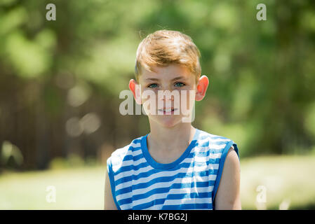 Boy outdoors, portrait - Stock Image