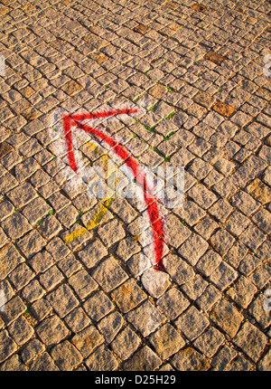An arrow points the way. - Stock Image