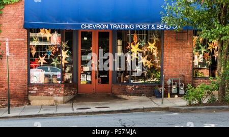 ASHEVILLE, NC, USA-24 JUNE 18: The Chevron Trading Post & Bead Co., in downtown Ashevile, with a bright collection of large beaded stars in the window - Stock Image