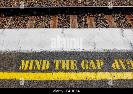 Warning notice on Melbourne suburban railway platform - Stock Image