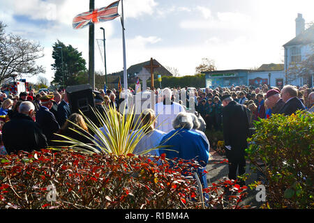 East Wittering Village, West Sussex, UK. 11th Nov, 2018. Local parishioners of  East wittering at their war memorial  to mark the 100 years anniversary of  the Armistice when the guns fell silent at the end of the Great War. Credit: Gary Blake/Alamy Live News - Stock Image
