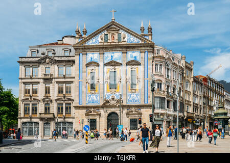 Porto, Portugal - April 29, 2019: Santo Antonio dos Congregados Church in Almeida Garrett Square. Baroque architecture decorated wih azulejos - Stock Image