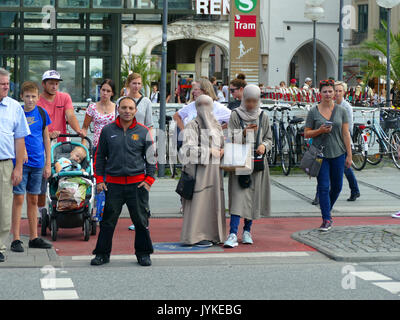Burqa headscarf Arab Arabic medical tourist European city Munich for treatment travel - Stock Image