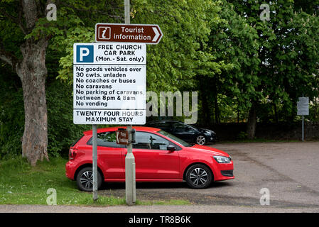 Tourist Information and Car Park signs with restrictions in Kingussie, Cairngorm National Park, Scotland, UK. - Stock Image