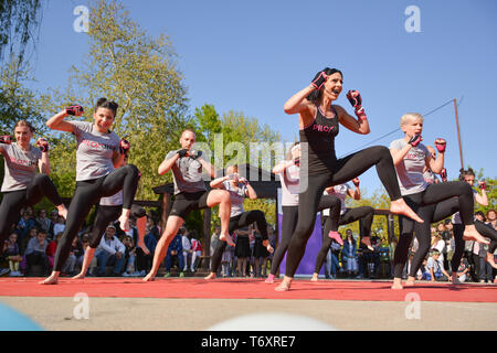 Nis, Serbia - April 20, 2019 Piloxing sport training big group of people on sunny spring day outdoor with instructor - Stock Image