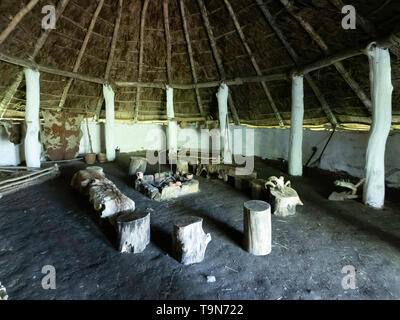 Interior of a full scale replica of an Iron Age dwelling house from circa 100 BC  in  Ryedale Folk Museum in Hutton le Hole North Yorkshire England - Stock Image