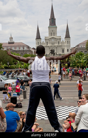 Street  performer stands facing St.Louis Cathedral, Jackson square, Louisiana - Stock Image