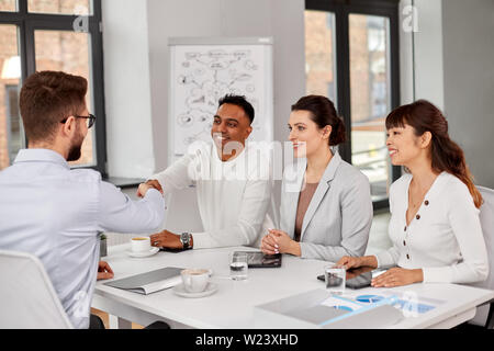 recruiters having interview with employee - Stock Image