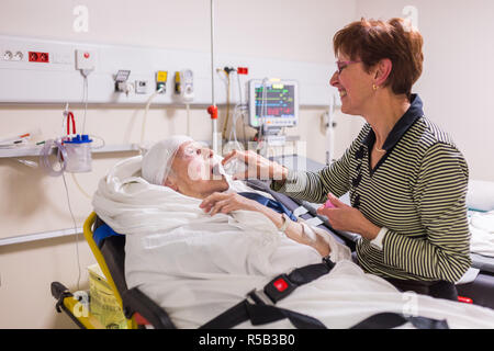 Elderly patient with her daughter at the Emergency department of a private hospital. - Stock Image