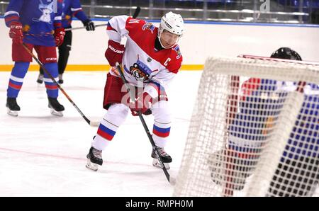 Sochi, Russia. 15th Feb, 2019. Russian President Vladimir Putin, #11, center, takes a shot on goal during a friendly ice hockey match with Belarus President Alexander Lukashenko at the Shaiba Arena February 15, 2019 in Sochi, Russia. Credit: Planetpix/Alamy Live News - Stock Image
