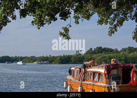 Relaxing Family Boating Holidays on The Norfolk Broads at Picturesque Malthouse Broad, Ranworth, Norfolk, England, - Stock Image