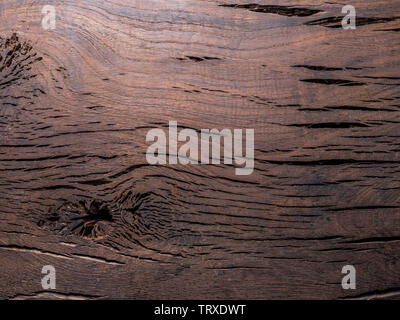 Old brown wooden background with knots and cracks.Close-up. - Stock Image