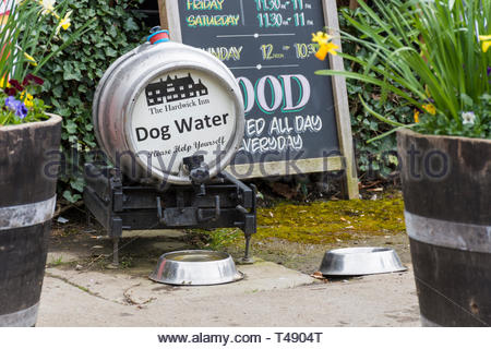 A barrel of water and dog bowls outside  the Hardwick Inn, Chesterfield, Derbyshire, England, UK - Stock Image