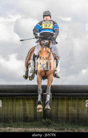 Rockingham Castle grounds, Corby, England. Saturday 20th May 2017. An unnamed spanish rider and his horse leap an - Stock Image
