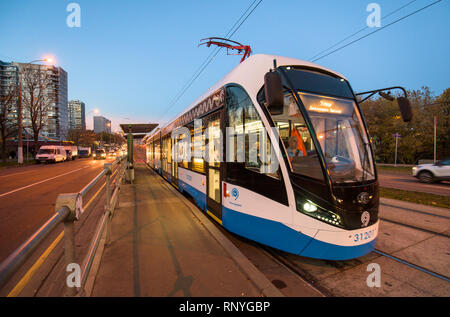 Russia, Moscow - 15 October, 2018: Modern city tram perspective rear view - Stock Image