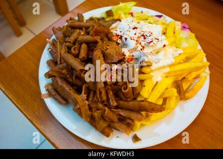 Kebab plate, with beef, chips, salad and yogurt dressing, Vinohrady, Prague, Czech Republic - Stock Image