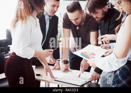 Successful business people are talking and smiling during in office. - Stock Image
