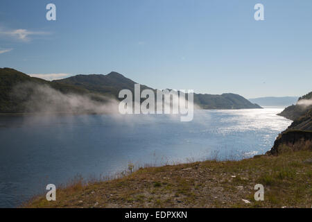 Picture of a fjord with some clouds in the midle - Stock Image