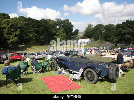 Spectators watch the action at the Prescott Hill Climb meeting of the Vintage Sports-Car Club. - Stock Image