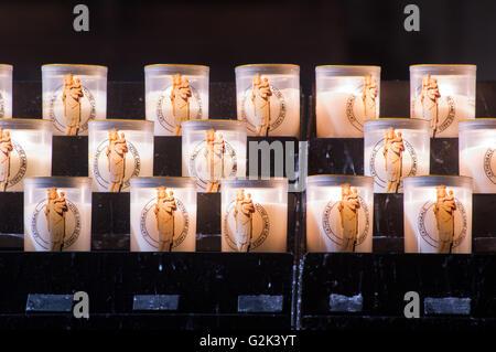 Votive candles in Notre Dame de Paris, France - Stock Image