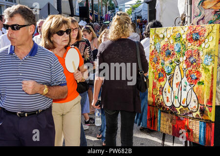 Fort Lauderdale Ft. Florida Las Olas Boulevard Las Olas Art Fair festival street fair community event art painting woman man loo - Stock Image
