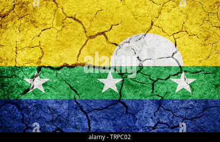 New Sparta State flag, state of Venezuela, on dry earth ground texture background - Stock Image