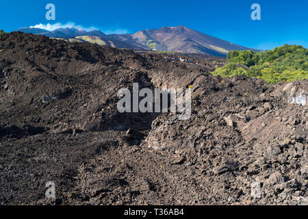 Lava field caused by volcanic eruption of Mount Etna an active stratovolcano on the east coast at Taormina, Sicily, Italy - Stock Image