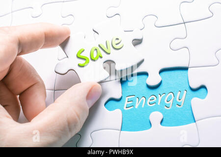 The Words Save And Energy In Missing Piece Jigsaw Puzzle - Stock Image