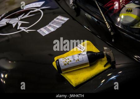 Bielsko-Biala, Poland. 12th Aug, 2017. International automotive trade fairs - MotoShow Bielsko-Biala. Cleaning spray with towel lying on a car hood. Credit: Lukasz Obermann/Alamy Live News - Stock Image