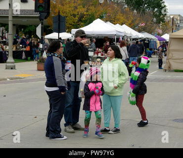 Two Rivers, Wisconsin USA, 13th Oct, 2018. Family pauses for refreshment while enjoying the street fair at Two Rivers Annual Autumn Applefest. Credit: Jerome Wilson/Alamy Live News - Stock Image