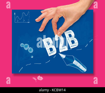 A hand picking up a business to business concept on a colorful drawing board. - Stock Image