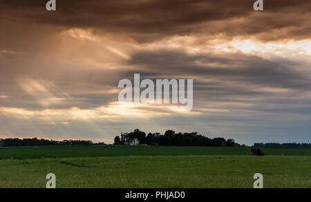 Sun Rays Fall Over Field in Rural Minnesota - Stock Image