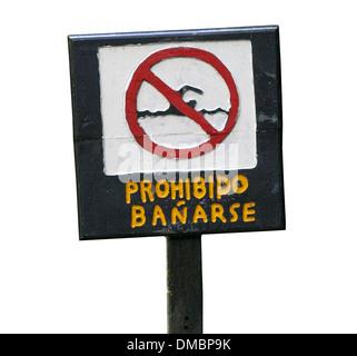 No Swimming sign in Spoanish - Prohibido Banarse - Stock Image