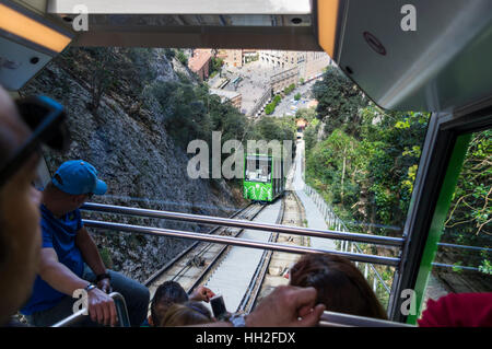 Ride in the funicular de Sant Joan in Montserrat, Catalonia, Spain. Looking down to the passing track with the second - Stock Image