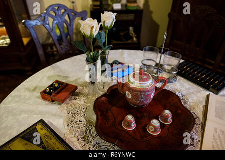 Tea set and games on table in Tjong A Fie's bedroom, Tjong A Fie Mansion, Medan, North Sumatra, Sumatra, Indonesia. - Stock Image