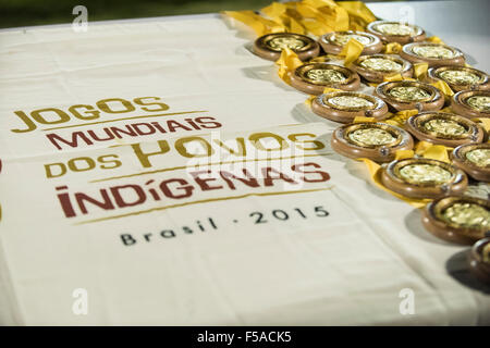 Palmas, Brazil. 30th October, 2015. Gold medals for the winners of the women's football lie on a table. The - Stock Image