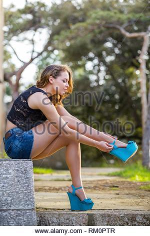 Blue high heeled platforms shoes - Stock Image