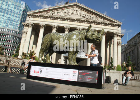 London, UK. 2 1 August 2018. A.D's Rhino Eterno painted by Adam Dant, outside the Royal Exchange, part of the 21 Tusk Rhino Trail installations on display in London. The rhinos, embellished by the internationally renowned artist will be on display until World Rhino Day on 22 September to raise awareness of the severe threat of poaching to the species' survival. They will then be auctioned by Christie's on 9 October to raise funds for the Tusk animal conservation charity. Credit: David Mbiyu / Alamy Live News - Stock Image