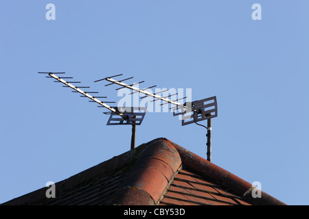Television aerials on rooftop - Stock Image