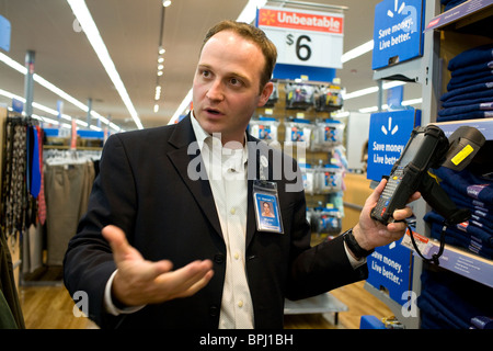 Myron Burke, director of store innovation for Walmart Stores U.S., talks about Walmart's use of EPC/RFID tags - Stock Image