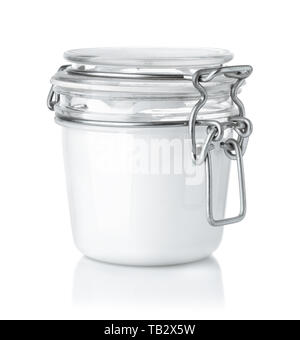 Front view of glass cosmetic cream jar isolated on white - Stock Image