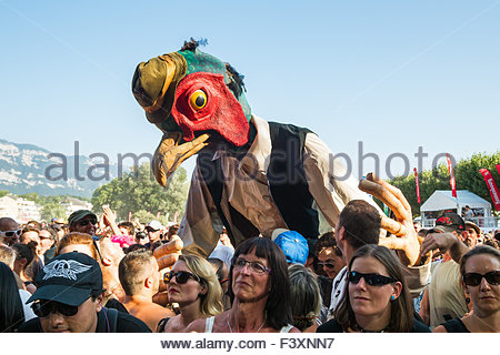 Strange bird within the public during concerts at Musilac summer festival - Aix-les-Bains (France) - Stock Image