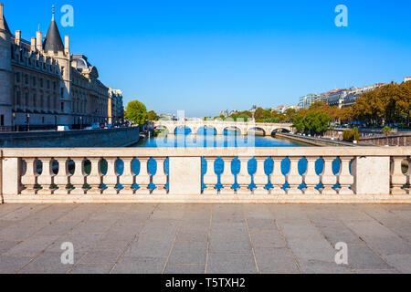 Bridge through Seine river in Paris city in France - Stock Image