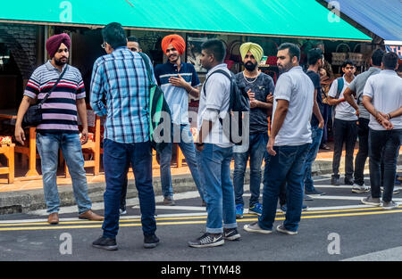 Group of Sikh Indian tourists in Baghdad Street Kampong Glam Singapore. - Stock Image